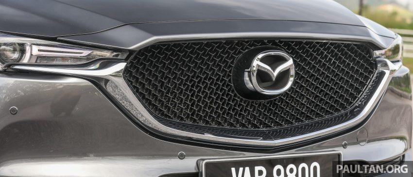 图集:Mazda CX-5 2.0 GL SkyActiv-G 2WD 与 2.2 GLS SkyActiv-D AWD, 两组实车照, 让你对比两个版本的差异。 Image #52436