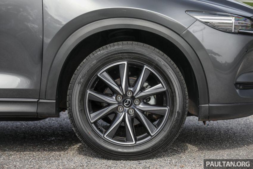图集:Mazda CX-5 2.0 GL SkyActiv-G 2WD 与 2.2 GLS SkyActiv-D AWD, 两组实车照, 让你对比两个版本的差异。 Image #52442