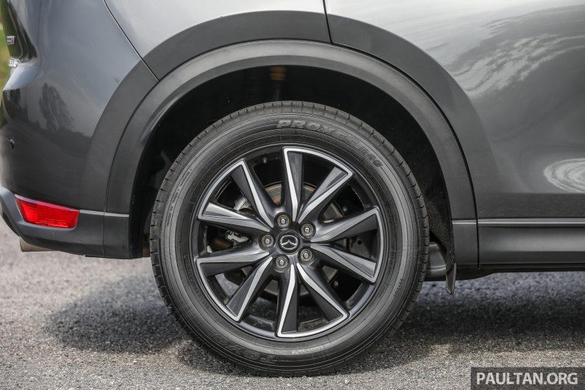 图集:Mazda CX-5 2.0 GL SkyActiv-G 2WD 与 2.2 GLS SkyActiv-D AWD, 两组实车照, 让你对比两个版本的差异。 Image #52443