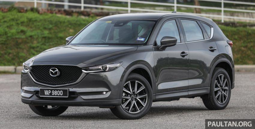 图集:Mazda CX-5 2.0 GL SkyActiv-G 2WD 与 2.2 GLS SkyActiv-D AWD, 两组实车照, 让你对比两个版本的差异。 Image #52426
