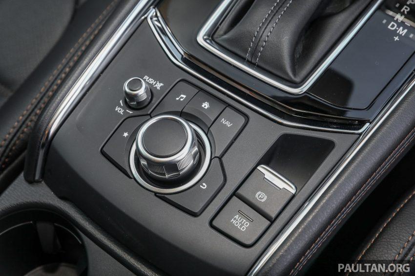 图集:Mazda CX-5 2.0 GL SkyActiv-G 2WD 与 2.2 GLS SkyActiv-D AWD, 两组实车照, 让你对比两个版本的差异。 Image #52465