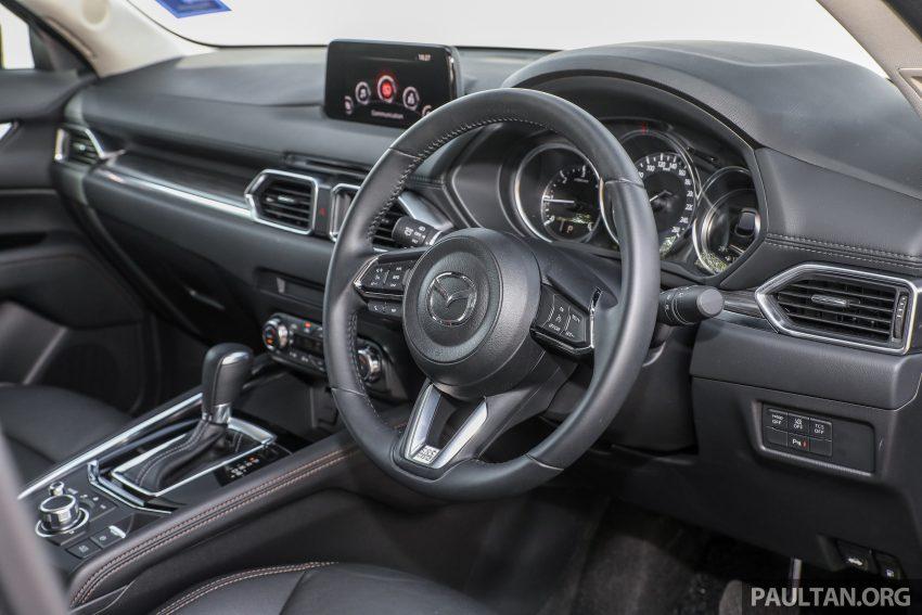 图集:Mazda CX-5 2.0 GL SkyActiv-G 2WD 与 2.2 GLS SkyActiv-D AWD, 两组实车照, 让你对比两个版本的差异。 Image #52456