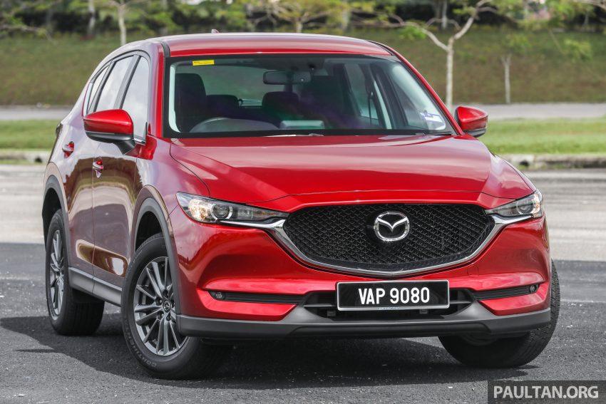 图集:Mazda CX-5 2.0 GL SkyActiv-G 2WD 与 2.2 GLS SkyActiv-D AWD, 两组实车照, 让你对比两个版本的差异。 Image #52350