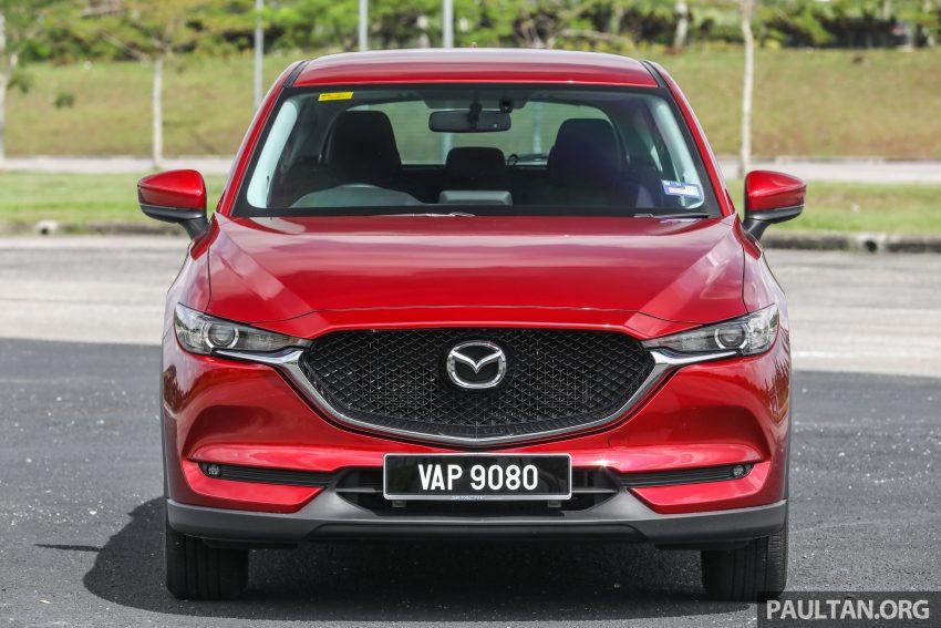 图集:Mazda CX-5 2.0 GL SkyActiv-G 2WD 与 2.2 GLS SkyActiv-D AWD, 两组实车照, 让你对比两个版本的差异。 Image #52360