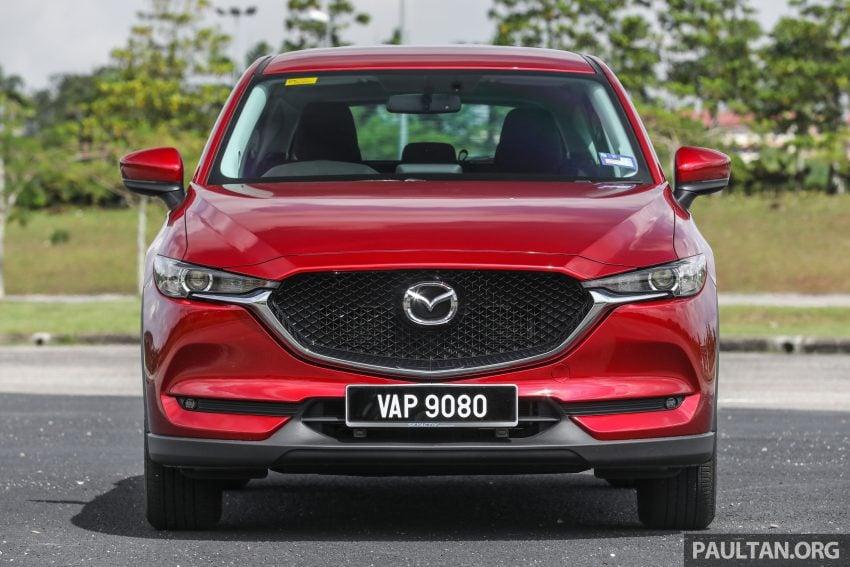 图集:Mazda CX-5 2.0 GL SkyActiv-G 2WD 与 2.2 GLS SkyActiv-D AWD, 两组实车照, 让你对比两个版本的差异。 Image #52361