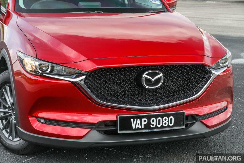 图集:Mazda CX-5 2.0 GL SkyActiv-G 2WD 与 2.2 GLS SkyActiv-D AWD, 两组实车照, 让你对比两个版本的差异。 Image #52364
