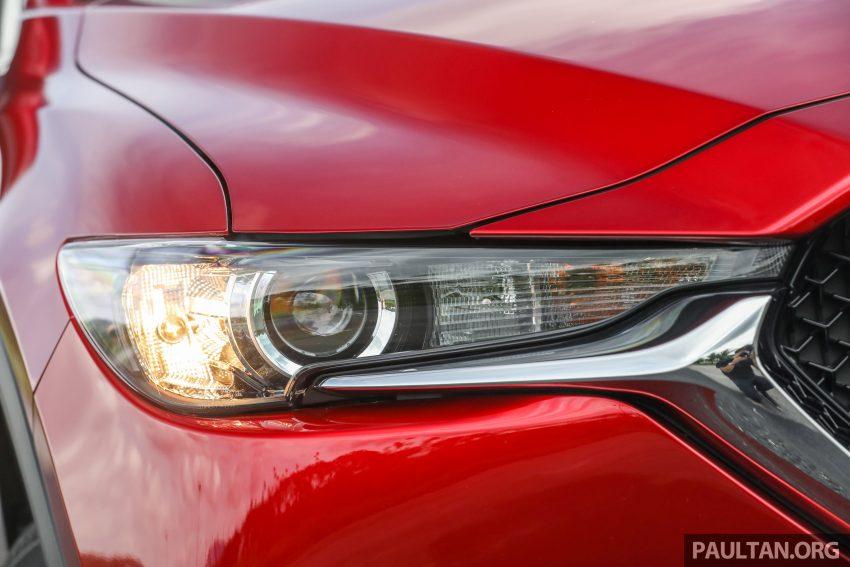 图集:Mazda CX-5 2.0 GL SkyActiv-G 2WD 与 2.2 GLS SkyActiv-D AWD, 两组实车照, 让你对比两个版本的差异。 Image #52365