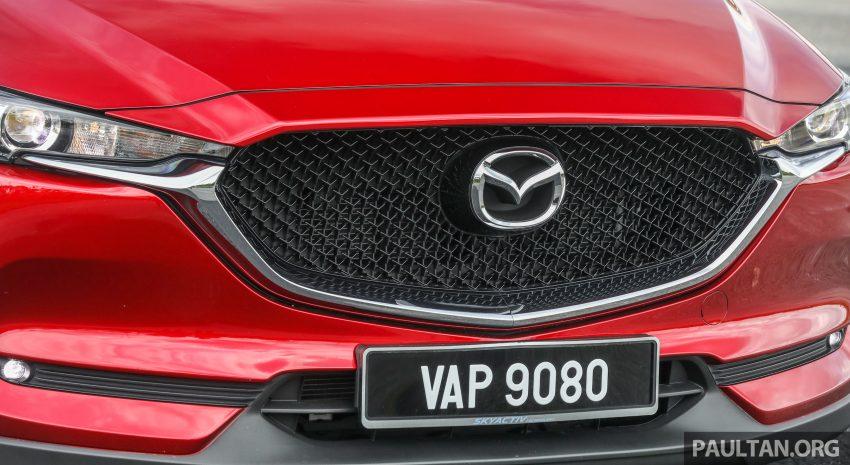图集:Mazda CX-5 2.0 GL SkyActiv-G 2WD 与 2.2 GLS SkyActiv-D AWD, 两组实车照, 让你对比两个版本的差异。 Image #52368
