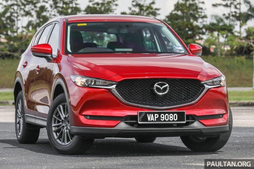 图集:Mazda CX-5 2.0 GL SkyActiv-G 2WD 与 2.2 GLS SkyActiv-D AWD, 两组实车照, 让你对比两个版本的差异。 Image #52351