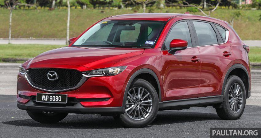图集:Mazda CX-5 2.0 GL SkyActiv-G 2WD 与 2.2 GLS SkyActiv-D AWD, 两组实车照, 让你对比两个版本的差异。 Image #52352