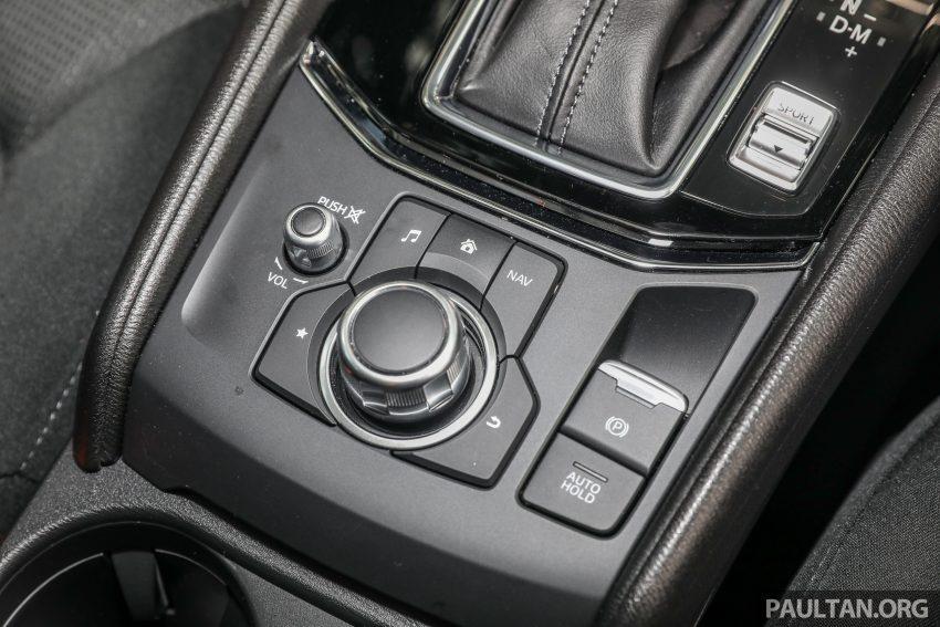 图集:Mazda CX-5 2.0 GL SkyActiv-G 2WD 与 2.2 GLS SkyActiv-D AWD, 两组实车照, 让你对比两个版本的差异。 Image #52398