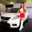 Model poses with the Nissan Almera Nismo