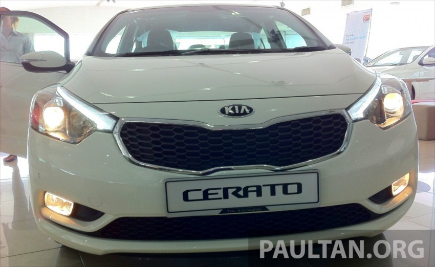 GALLERY: Kia Cerato at the showroom with brochure Image #184336