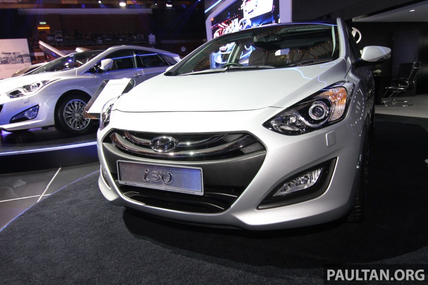 Hyundai i30 hatchback and Veloster Turbo previewed at KLIMS13, both launching in 2014 Image #212603