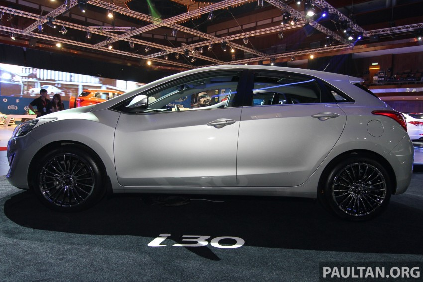 Hyundai i30 hatchback and Veloster Turbo previewed at KLIMS13, both launching in 2014 Image #212604
