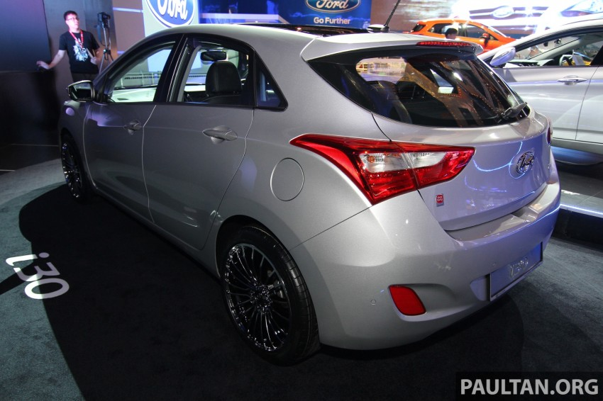 Hyundai i30 hatchback and Veloster Turbo previewed at KLIMS13, both launching in 2014 Image #212601