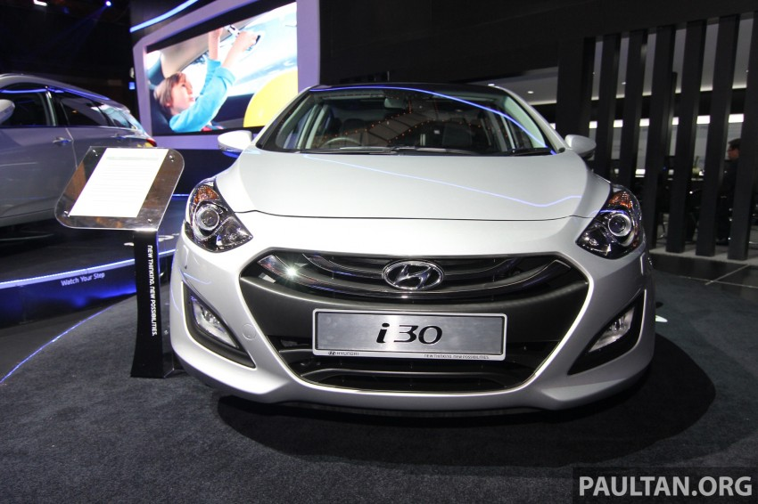 Hyundai i30 hatchback and Veloster Turbo previewed at KLIMS13, both launching in 2014 Image #212600