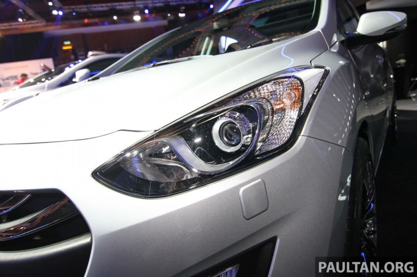 Hyundai i30 hatchback and Veloster Turbo previewed at KLIMS13, both launching in 2014 Image #212596