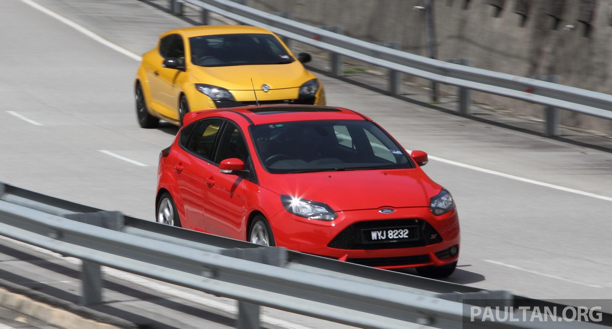 driven ford focus st vs renault megane rs 265 paul tan image 224655. Black Bedroom Furniture Sets. Home Design Ideas