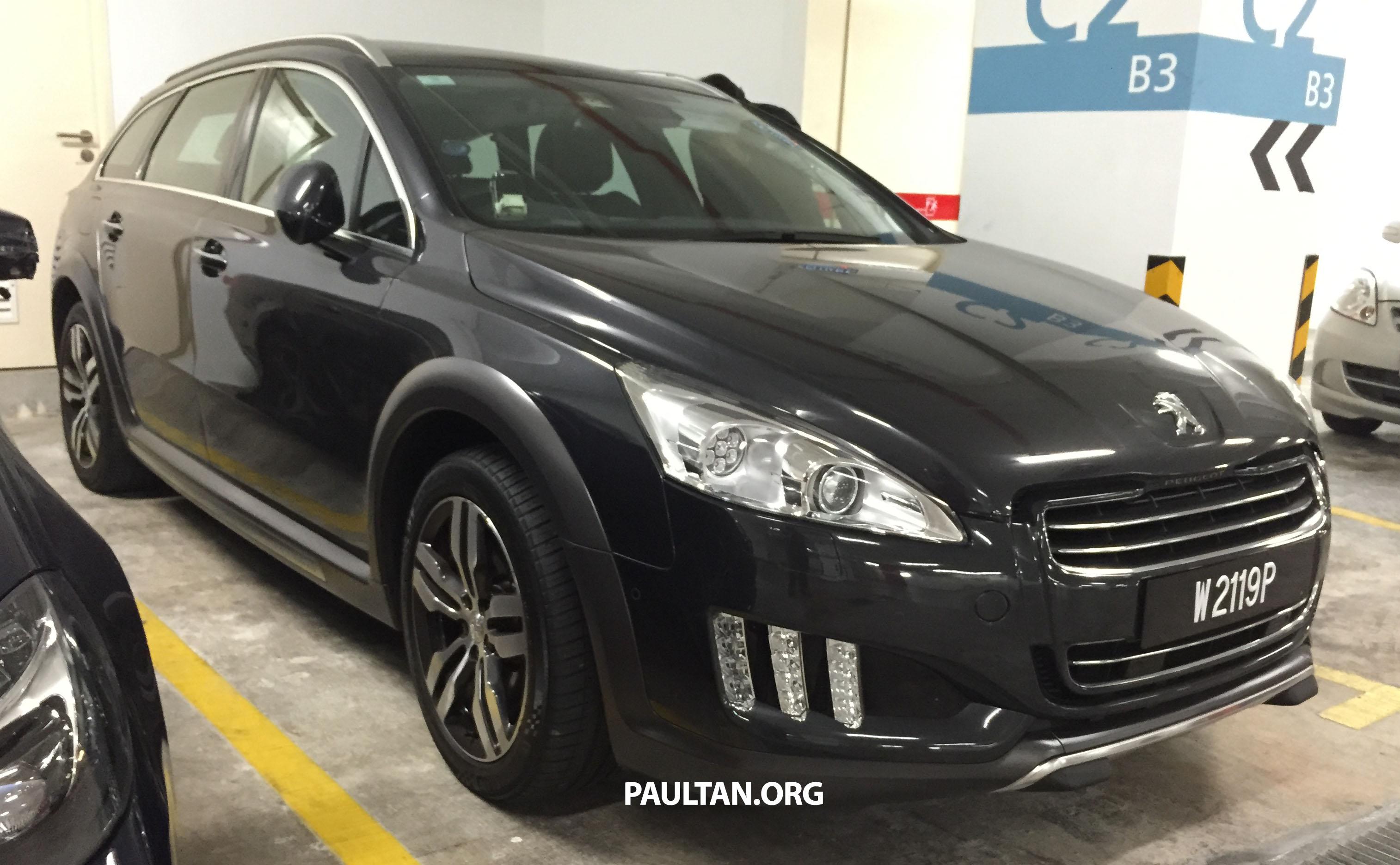 spied: peugeot 508 rxh hybrid4 in basement parking