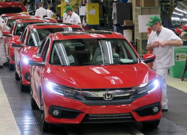 Honda of Canada Mfg. associates perform final inspections