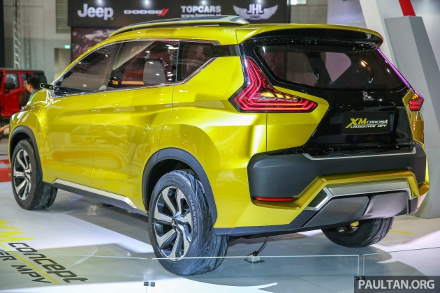 The XM Features Mitsubishis New Dynamic Shield Front End Design With Slit Like Headlights Flanking A Large Black Grille Flared Wheel Arches And