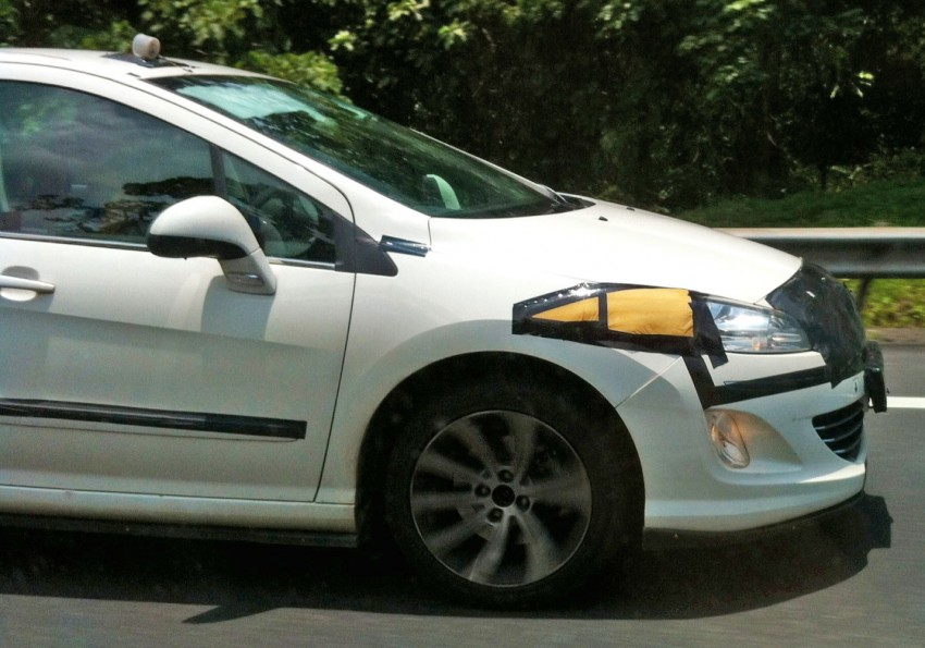 White Peugeot 408 with black tape testing on the NSE Image #99952