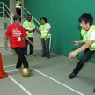 A finalist dribbling a football in one of the challenges during the Shell Helix Get Your Heart Racing Contest finale