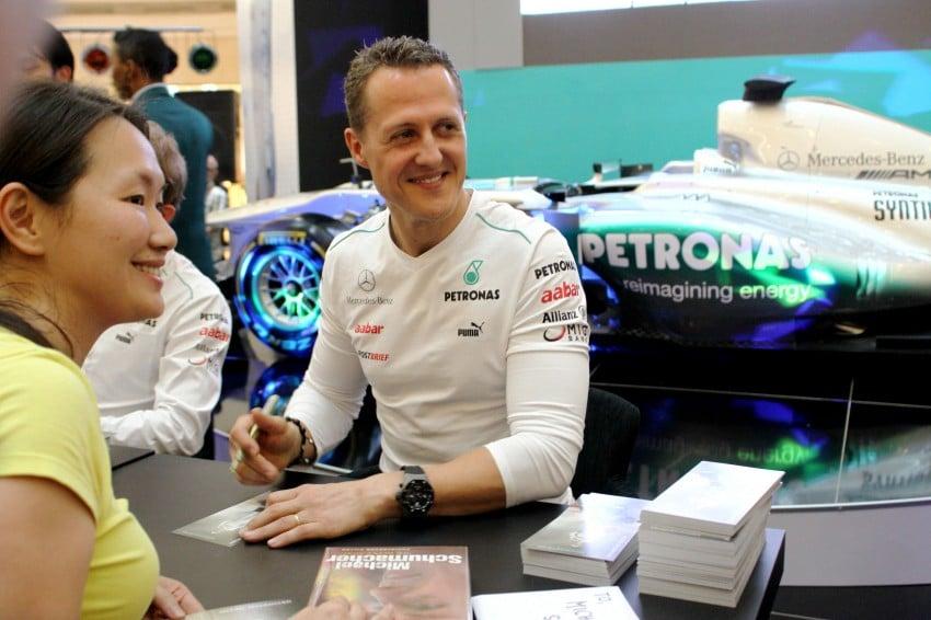 Michael Schumacher and Nico Rosberg meet & greet fans Image #95250