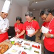 Shell Helix contest finalists trying to correctly identify ingredients of the pizza