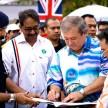 Sultan of Johor, Sultan Ibrahim Ibni Almarhum Sultan Iskandar with Andrew Suresh, Curator of Historic Motoring Ventures signing a participant's book