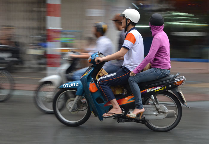 Indonesian city plans to ban women straddling motorbikes, with only side-saddle seating allowed Image #148480
