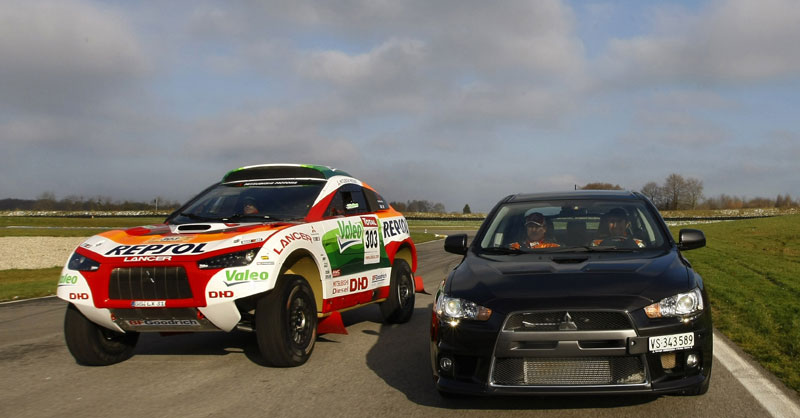 Mitsubishi Racing Lancer And Mitsubishi Lancer Evolution X Side By Side Comparison Photos