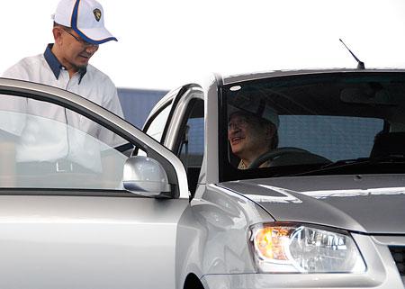 Pak Lah driving a Proton Saga