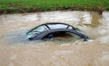 Woman Drives Car Into River